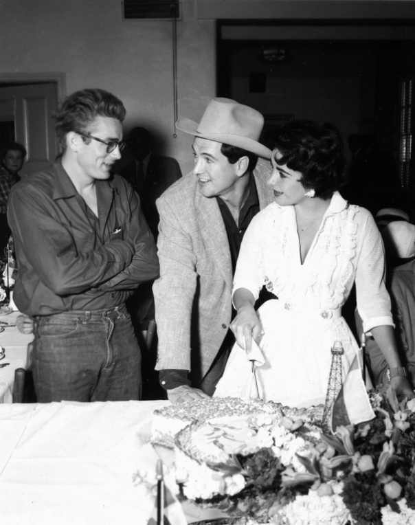 James Dean, Rock Hudson, and Elizabeth Taylor celebrate during the filiming of Giant.